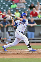 Tennessee Smokies right fielder Billy McKinney (4) swings at a pitch during a game against the Mobile BayBears on May 27, 2015 in Kodak, Tennessee. The Smokies defeated the BayBears 3-2. (Tony Farlow/Four Seam Images)
