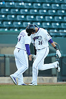 Craig Dedelow (26) of the Winston-Salem Dash slaps hands with Winston-Salem Dash manager Justin Jirschele (9) as he rounds third base after hitting a home run against the Wilmington Blue Rocks at BB&T Ballpark on April 15, 2019 in Winston-Salem, North Carolina. The Dash defeated the Blue Rocks 9-8. (Brian Westerholt/Four Seam Images)