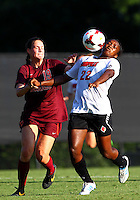 WINSTON-SALEM, NORTH CAROLINA - August 30, 2013:<br />  Christine Exeter (22) of Louisville University pulls down a high pass in front of Jordan Coburn (19) of Virginia Tech during a match at the Wake Forest Invitational tournament at Wake Forest University on August 30. The game ended in a 1-1 tie.
