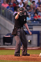 Home plate umpire Ryan Wills makes a call during a game between the Midland RockHounds and Tulsa Drillers on May 30, 2014 at ONEOK Field in Tulsa, Oklahoma.  Tulsa defeated Midland 7-1.  (Mike Janes/Four Seam Images)