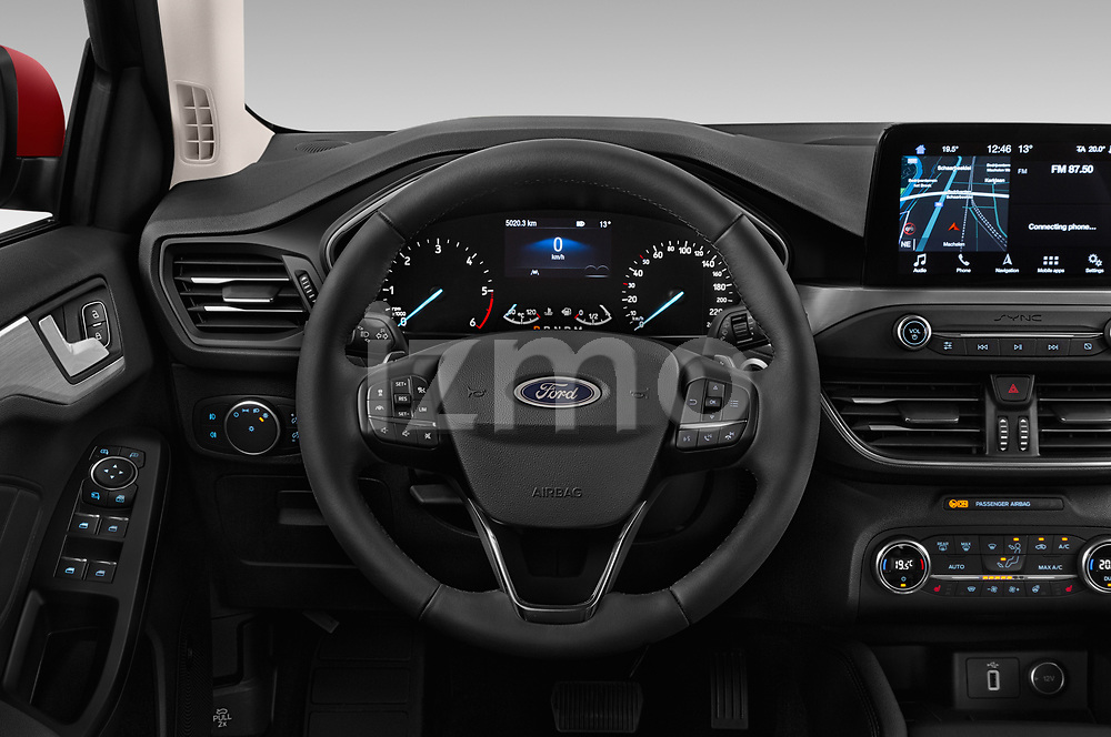 Car pictures of steering wheel view of a 2019 Ford Focus Titanium Business 5 Door Hatchback