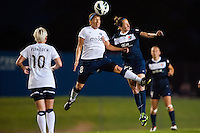 Seattle Reign FC midfielder Teresa Noyola (8) goes up for a header with Sky Blue FC midfielder Manya Makoski (22). Sky Blue FC defeated the Seattle Reign FC 2-0 during a National Women's Soccer League (NWSL) match at Yurcak Field in Piscataway, NJ, on May 11, 2013.