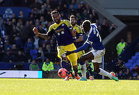 Pictured L-R: Kyle Bartley of Swansea is fouled by Lacina Traore of Everton. Sunday 16 February 2014<br /> Re: FA Cup, Everton v Swansea City FC at Goodison Park, Liverpool, UK.