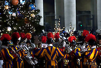 band Swiss Guards,Pope Francis prays in front of a Nativity scene in St Peter's square at the Vatican  on December 31, 2016