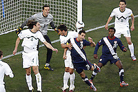 Carlos Bocanegra (R) of USA battles for the ball in the Slovenia penalty area