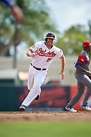 Baltimore Orioles first baseman Chris Davis (19) running the bases during a Spring Training exhibition game against the Dominican Republic on March 7, 2017 at Ed Smith Stadium in Sarasota, Florida.  Baltimore defeated the Dominican Republic 5-4.  (Mike Janes/Four Seam Images)