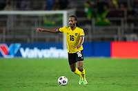ORLANDO, FL - JULY 20: Daniel Johnson #16 of Jamaica dribbles the ball during a game between Costa Rica and Jamaica at Exploria Stadium on July 20, 2021 in Orlando, Florida.