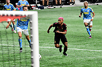 ATLANTA, GA - APRIL 27: Atlanta United forward #7 Josef Martinez breaks in on goal during a game between Philadelphia Union and Atlanta United FC at Mercedes-Benz Stadium on April 27, 2021 in Atlanta, Georgia.