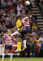 COLUMBUS, OHIO - SEPTEMBER 11, 2012:  Maurice Edu (7) of the USA MNT wins a header from Rodolph Austin (17) of  Jamaica during a CONCACAF 2014 World Cup qualifying  match at Crew Stadium, in Columbus, Ohio on September 11. USA won 1-0.