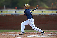 Zach Weston (9) of the Queens Royals follows through on his swing against the Catawba Indians during game one of a double-header at Tuckaseegee Dream Fields on March 26, 2021 in Kannapolis, North Carolina. (Brian Westerholt/Four Seam Images)