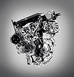 Cross section of 2017 Buick Lacrosse 3.6L V6 VVT DI 310HP car engine showing the cylinder, piston and valves isolated with clipping path on gray background Image © MaximImages, License at https://www.maximimages.com