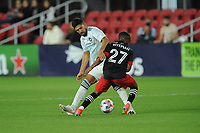 WASHINGTON, DC - MAY 13: Mauricio Pineda #22 of Chicago Fire FC battles for the ball with Moses Nyeman #27 of D.C. United during a game between Chicago Fire FC and D.C. United at Audi FIeld on May 13, 2021 in Washington, DC.