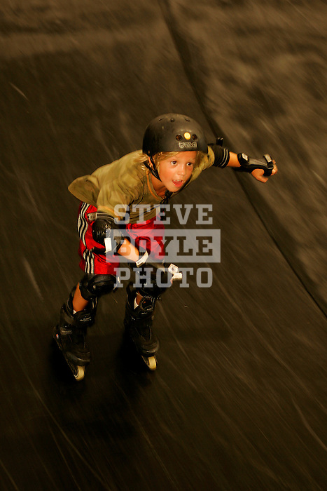 In-line skater Jack Kaplan, 8, of Long Beach, New York, skates down the resi (short for resin) vert ramp in Cloud-9 at Camp Woodward in Woodward, Pennsylvania.  August 15, 2005.