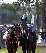 Flat Top and Britt Graham pony Johnny Fitz before 2003 Colonial Cup races.