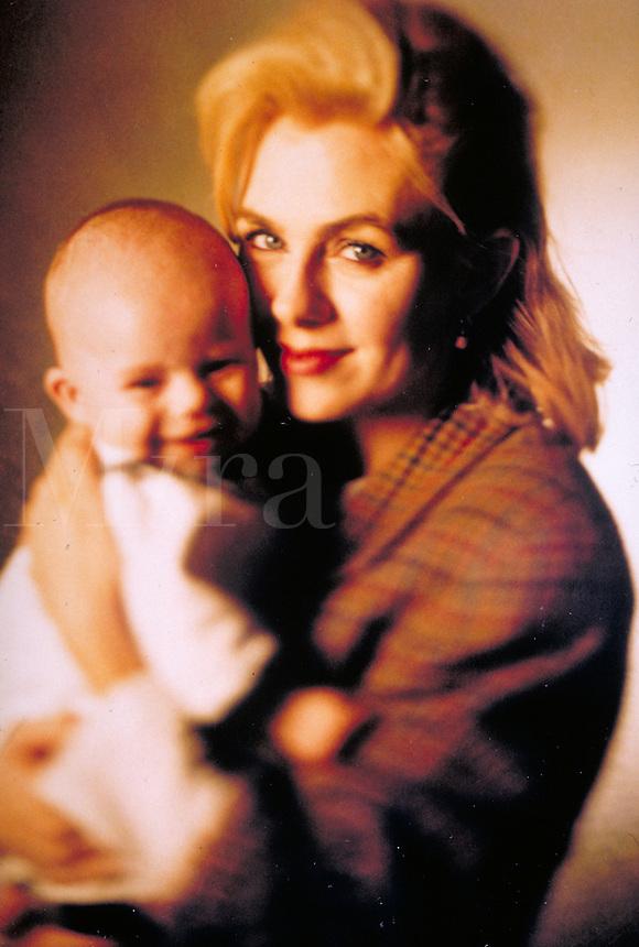 portrait of woman holding her 4 month old baby girl. Birmingham AL USA studio.