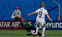 GRENOBLE, FRANCE - JUNE 22: Evelyn Nwabuoku #6 of the Nigerian National Team tackles Svenja Huth #9 of the German National Team during a game between Panama and Guyana at Stade des Alpes on June 22, 2019 in Grenoble, France.