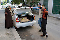 Tripoli, Libya - Eid al-Adha, Id al-Adha.  Family Transporting Two sheep in Car Trunk (Boot) for the annual feast when Muslims commemorate God's mercy in allowing Abraham to sacrifice a ram instead of his son, to prove his faith.