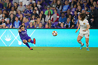 Orlando, FL - Saturday March 24, 2018: Orlando Pride forward Marta Vieira da Silva (10) plays the ball between two opponents during a regular season National Women's Soccer League (NWSL) match between the Orlando Pride and the Utah Royals FC at Orlando City Stadium. The game ended in a 1-1 draw.