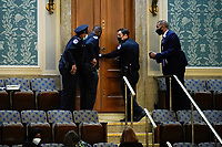 U.S. Capitol Police secure a door as protesters try to break into the House Chamber at the U.S. Capitol on Wednesday, Jan. 6, 2021, in Washington. (AP Photo/J. Scott Applewhite)