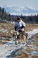 Sunday March 11, 2007   ----    Paul Gebhart runs on the tundra nearing Unalakleet on Sunday afternoon.