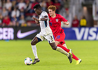 WASHINGTON, DC - OCTOBER 11: Erick Rizo #3 of Cuba dribbles past Josh Sargent #19 of the United States during a game between Cuba and USMNT at Audi Field on October 11, 2019 in Washington, DC.