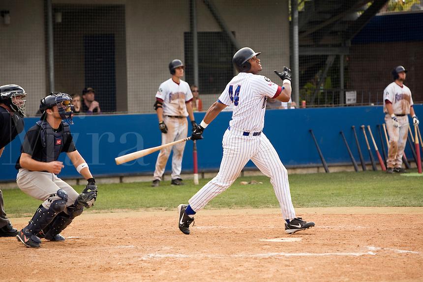 Baseball player watching his hit.