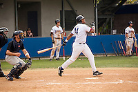 Baseball player watching his hit.