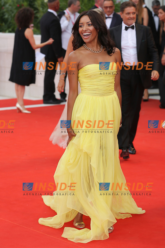 "VENICE, ITALY - AUGUST 28:  Kat Graham walks the red carpet ahead of the Opening Ceremony and the ""La Verite"" (The Truth) screening during the 76th Venice Film Festival at Sala Grande on August 28, 2019 in Venice, Italy., 2019 in Venice, Italy. (Photo by Marck Cape/Inside Foto)<br /> Venezia 28/08/2019"