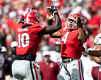 ATHENS, GA - OCTOBER 12: Nolan Smith #4 and Malik Herring #10 of the Georgia Bulldogs celebrate after a big stop during a game between University of South Carolina Gamecocks and University of Georgia Bulldogs at Sanford Stadium on October 12, 2019 in Athens, Georgia.