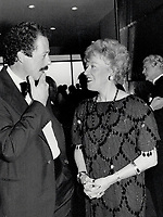 1987 FILE PHOTO - ARCHIVES -<br /> <br /> Arcand sweeps the Genie awards. Flora MacDonald, federal communications minister, enjoys one of her more pleasant tasks as she chats with Quebec movie director Denys Arcand at the Genie party in Sutton Place Hotel last night. Arcand's The Decline Of The<br /> <br /> PHOTO :  Jeff Goode - Toronto Star Archives - AQP