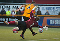 Alloa's Darren Young goes around Ayr Utd Goalkeeper Ally Brown but knocks his shot wide.