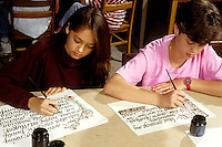 Student working on Calligraphy writing practice in class in grade 7-