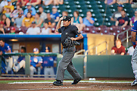 Home plate umpire Nestor Ceja halts play between the Round Rock Express and Omaha Storm Chasers at Werner Park on May 27, 2018 in Papillion , Nebraska. Round Rock defeated Omaha 8-3. (Stephen Smith/Four Seam Images)