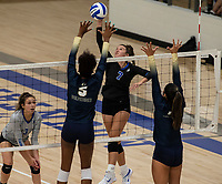 Lauryn Heinle (7) of Rogers hits ball through block of Trinity Luckett (5) of Bentonville West at Rogers High School, Rogers, AR, on Thursday, September 9, 2021 / Special to NWADG David Beach