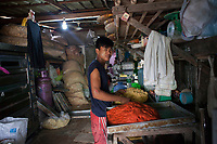One of the workers who are employed by Nila* and her husband. They run a home-based business baking cakes and packaging dry noodles which are sold in local markets. All workers work around 10-12 hours a day.