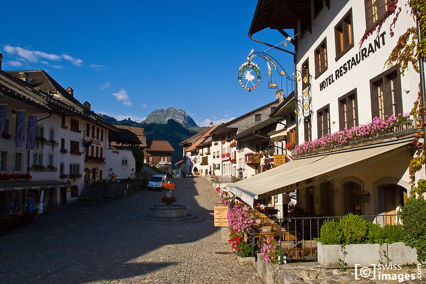 View of La Gruyère's main street with Le Moléson in the background