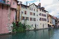 France, Annecy. Rhone-Alpes, Haute-Avoie. The Venice of Savoie, north of the French Alps. Old buildings along the canals in Annecy.