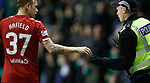 20.12.2019 Hibs v Rangers: Scott Arfield hands missiles to the police as Borna Barisic gets treatment