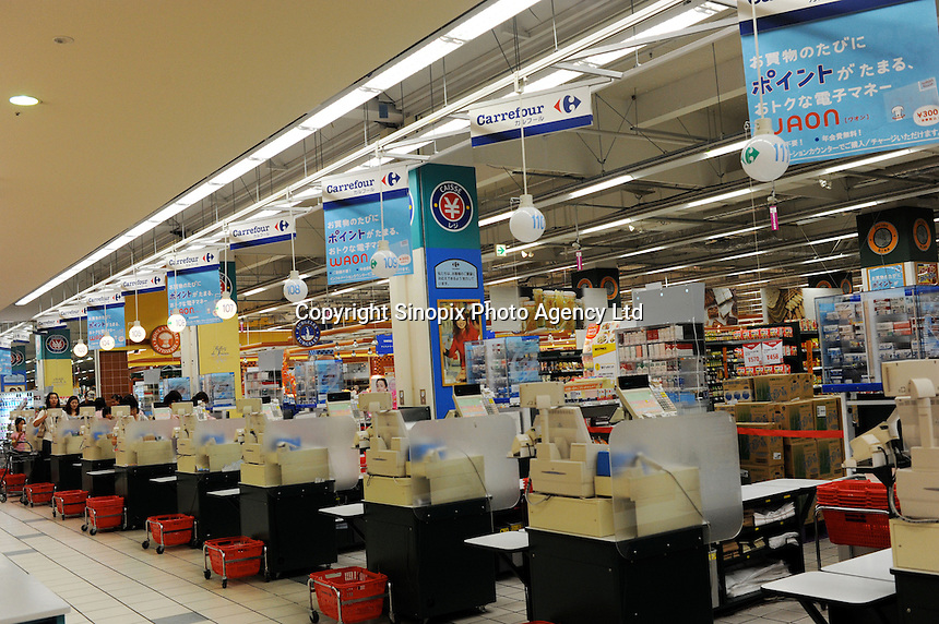 Empty tills at a branch of the French retailer Carrefour in Sayama, Saitama Prefecture, Japan. Carrefour sold it's stores to Japanese Company EON in 2005. The Sayama store was virtually deserted on Wednesday evening..