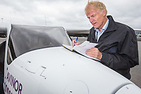 June 18th 2018 saw the first official flight by an electric aircraft in Norway. <br /> <br /> Civil Aviation Authority (Avinor) CEO Dag Falk-Petersen writes in the log book after taking  Minister of Transport and Communications Ketil Solvik-Olsen for a short flight around Gardermoen Airport. <br /> <br /> The plane is battery operated and signals a focus on more envorinmentally friendly solutions for the fututre. The project is supported by the government, and the project partners are Widerøe, SAS, the Norwegian Association of Air Sports, and climate foundation ZERO.<br /> <br />  © Fredrik Naumann/Felix Features