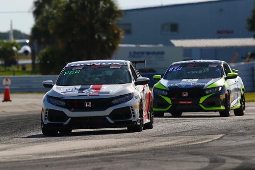 Skip Barber Racing School Honda Civic Type R:Eric Powell<br /> <br /> LA Honda World Racing Honda Civic Si:Mario Biundo
