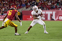 LOS ANGELES, CA - SEPTEMBER 11: Austin Jones #20 of the Stanford Cardinal runs with the ball after a pass reception defended by Isaac Taylor-Stuart #6 of the USC Trojans during a game between University of Southern California and Stanford Football at Los Angeles Memorial Coliseum on September 11, 2021 in Los Angeles, California.
