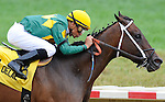 Inauguration, ridden by Mike Smith, wins an overnight stakes race on the undercard on Delaware Handicap Day at Delaware Park in Stanton, Delaware on July 21, 2012