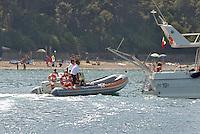 - the Coastguard  controls yachts near a beach of Elba island....- la Guardia Costiera controlla gli yachts vicino ad una spiaggia dell'isola d'Elba