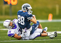 8 October 2016: Amherst College Purple & White Defensive Back Drew Bryant, a Junior from Los Angeles, CA, tackles Middlebury College Panther Wide Receiver Conrado Banky, a Sophomore from Katy, Texas, at Alumni Stadium in Middlebury, Vermont. The Panthers edged out the Purple & While 27-26. Mandatory Credit: Ed Wolfstein Photo *** RAW (NEF) Image File Available ***