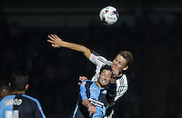 Matt Smith of Fulham and Joe Jacobson of Wycombe Wanderers go up for the ball during the Capital One Cup match between Wycombe Wanderers and Fulham at Adams Park, High Wycombe, England on 11 August 2015. Photo by Andy Rowland.