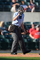 Home plate umpire Matthew Czajak makes a call during a game between the San Antonio Missions and Arkansas Travelers on May 25, 2014 at Dickey-Stephens Park in Little Rock, Arkansas.  Arkansas defeated San Antonio 4-2.  (Mike Janes/Four Seam Images)