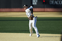 Wake Forest Demon Deacons shortstop Michael Turconi (6) makes a throw to first base against the Louisville Cardinals at David F. Couch Ballpark on March 7, 2020 in  Winston-Salem, North Carolina. The Demon Deacons defeated the Cardinals 3-2. (Brian Westerholt/Four Seam Images)