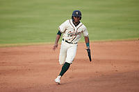 Matthew Fraizer (14) of the Greensboro Grasshoppers hustles towards third base against the Wilmington Blue Rocks at First National Bank Field on May 25, 2021 in Greensboro, North Carolina. (Brian Westerholt/Four Seam Images)
