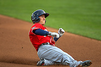 Daniel Robertson (2) of the Tacoma Rainiers slides into third base against the Salt Lake Bees in Pacific Coast League action at Smith's Ballpark on June 14, 2016 in Salt Lake City, Utah. The Bees defeated the Rainiers 9-4.  (Stephen Smith/Four Seam Images)